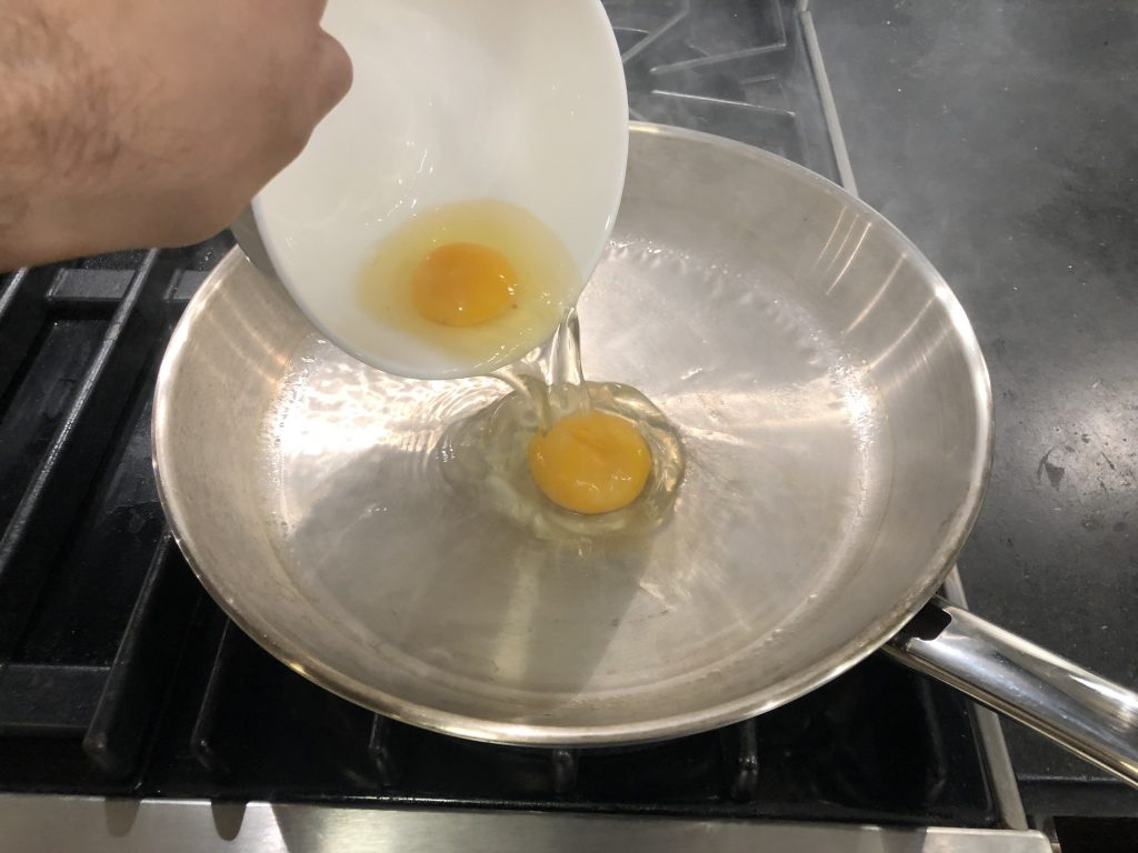 Fried Eggs added to pan